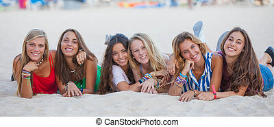 mixed race group of happy summer teens