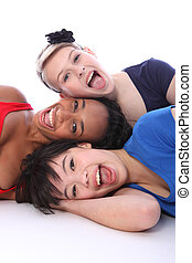 Mixed race happy girls tower of smiling faces - Fun tower of...