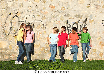 mixed race kids hanging out together