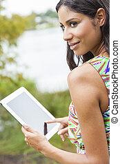 Mixed Race Latina Woman Using Tablet Computer