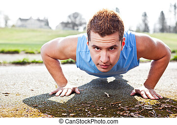 Mixed race man doing push up - A shot of a mixed race man...