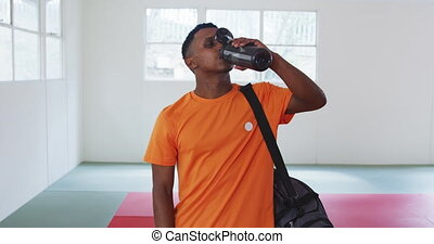 Mixed race man drinking water