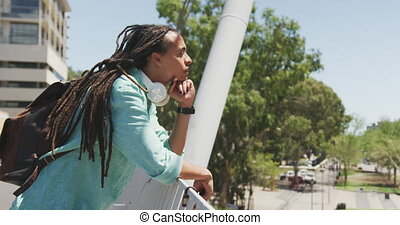 Mixed race man talking on the phone - Side view of a mixed ...