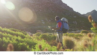 Mixed race man with prosthetic leg hiking in nature - Fit, ...