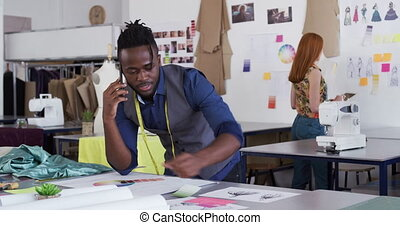 Mixed race man working in creative office
