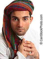 Mixed race middle eastern man