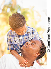 Mixed Race Son and African American Father Playing Outdoors Together.