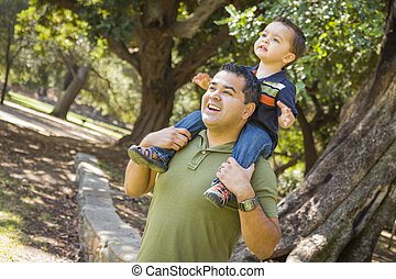 Mixed Race Son Enjoy a Piggy Back in the Park with Dad