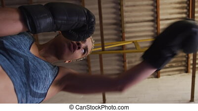 Mixed race woman boxing - Low angle view, looking up at a ...