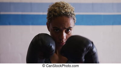 Mixed race woman boxing - Portrait close up of a mixed race ...