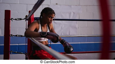 Mixed race woman in boxing gym - Side view of a mixed race ...