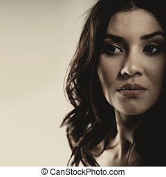 Mixed race woman looking far away. Dramatic female portrait