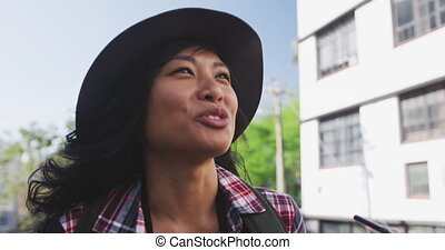 Mixed race woman on the phone - Low angle side view of a ...