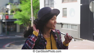 Mixed race woman on the phone - Side view of a happy mixed ...