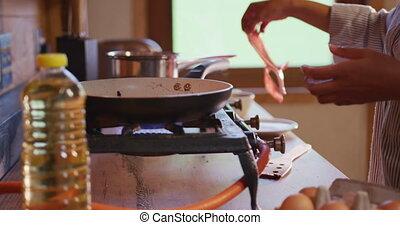 Mixed race woman preparing breakfast at home