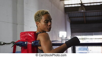 Mixed race woman resting after working out