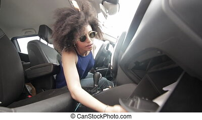 Mixed race woman searching for driving and car documents