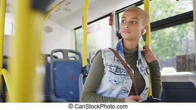 Mixed race woman taking the bus - Front view of happy mixed ...