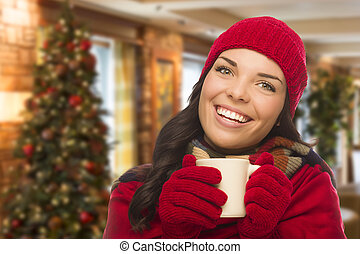 Mixed Race Woman Wearing Hat and Gloves In Christmas Setting