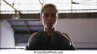 Mixed race woman with boxing gloves - Portrait of a mixed ...