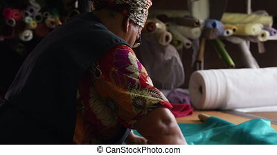 Mixed race woman working at a hat factory - Side view close ...