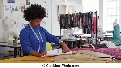 Mixed race woman working in creative office