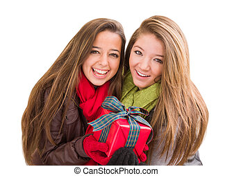 Mixed Race Young Adult Females Holding A Christmas Gift Isolated on a White Background.
