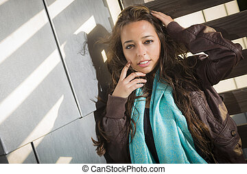 Mixed Race Young Adult Woman Against a Wood and Metal Wall