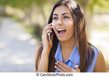 Mixed Race Young Adult Woman Using Her Cell Phone