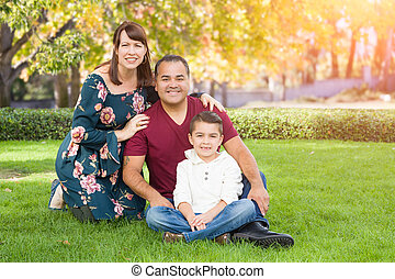 Mixed Race Young Family Portrait At The Park