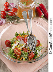 salad in a glass bowl with vinaigrette