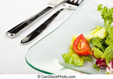 mixed salad on a glass plate