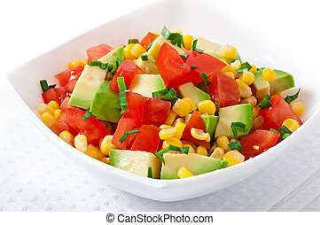 Mixed salad with avocado, tomatoes and sweet corn