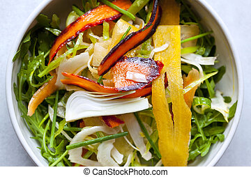 Mixed salad and oil in a bowl