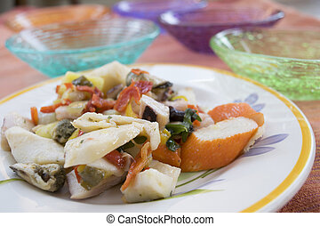 mixed seafood salad in a white dish