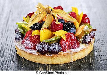 Fresh dessert fruit tart covered in assorted tropical fruits