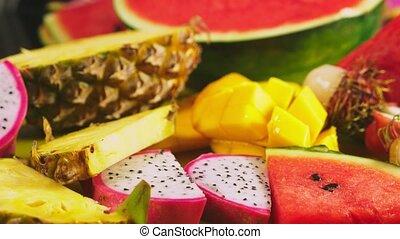 Mixed tropical fruits, closeup. fresh fruit sliced....