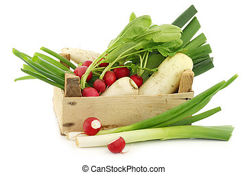 mixed vegetables in a wooden crate