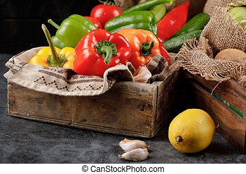 Mixed vegetables in a wooden rustic tray.