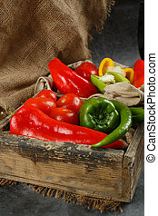 Mixed vegetables in a wooden tray.