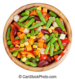 mixed vegetables in wooden bowl isolated, top view