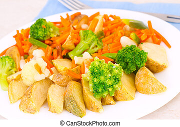 Mixed vegetables on a plate with fork