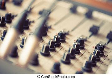 Professional mixer board in a studio sound.