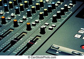 Mixer - The musical Kind - Closeup of a mixer on a four...