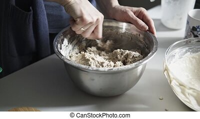 Mixing a bread dough - Detail of mixing bread dough with a ...