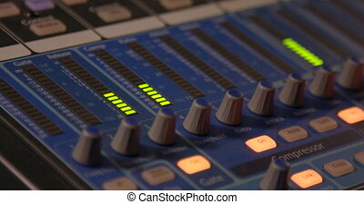 Mixing Board. Sweeping across the master controls of a professional sound mixing board.