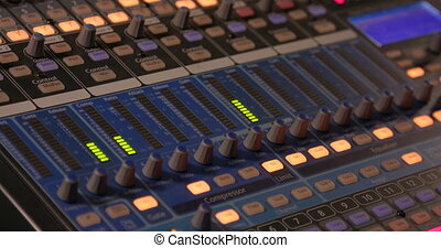 Mixing Board. Sweeping across the master controls of a...