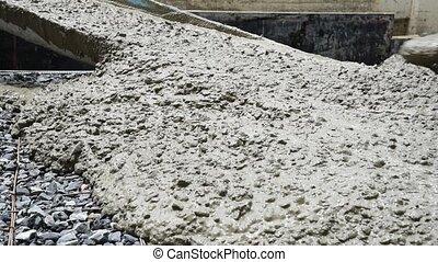 Mixing cement concrete at construction site