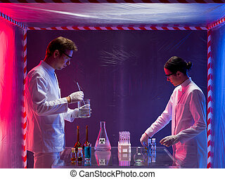 mixing chemicals in a containment tent