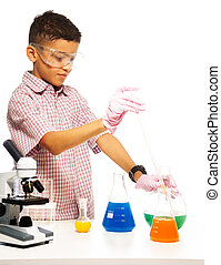 Mixing chemicals with dropper - Black boy with chemistry ...
